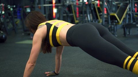 Girl working out in plank crunch