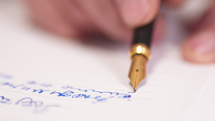 SLOW MOTION: Close up of old man writing with pen. Elderly gentleman uses pen with ink to write on paper, at his home.