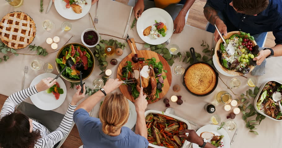 Top view of woman carving thanksgiving  turkey young cheerful multi ethnic friends preparing table enjoying vibrant festive season meal together talking bonding over healthy food time lapse rotate