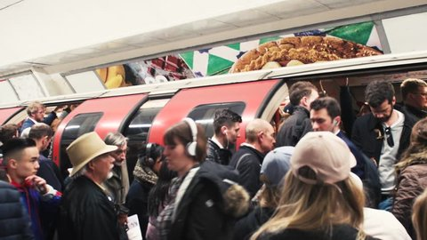 LONDON, UNITED KINGDOM - CIRCA 2018: London underground subway train station with crowd embark the train