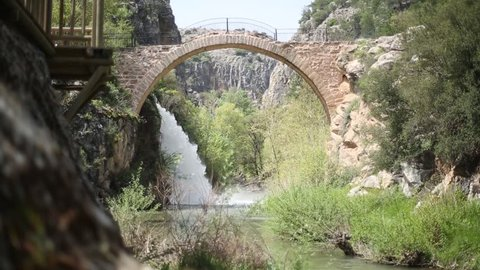 Clandras Bridge and Waterfall and River in Usak,Turkey. Clandras bridge built by Phrygians.