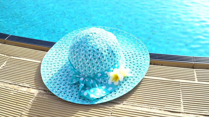 Happy Weekend background, design hat on swimming pool edge with blurred blue water