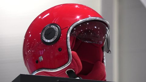 BUCHAREST, ROMANIA, 20 of April 2018; Motorcycle and accessories exhibition Red Vespa helmet on rotating display at motorcycle exhibition