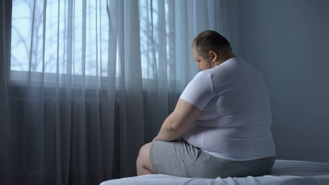 Fat man massaging neck, back pain problem, lack physical activity, rheumatology