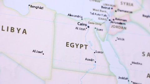 Egypt on a political map of the world. Video defocuses showing and hiding the map.