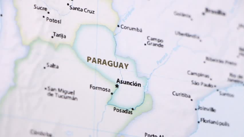 Paraguay on a political map of the world. Video defocuses showing and hiding the map.