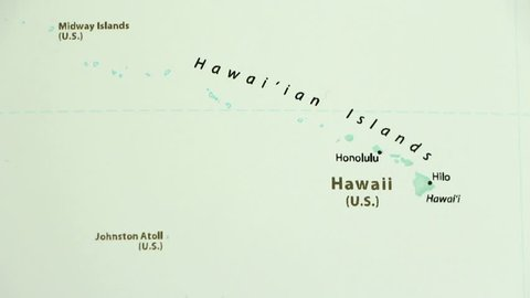 Hawaii on a political map of the world. Video defocuses showing and hiding the map.