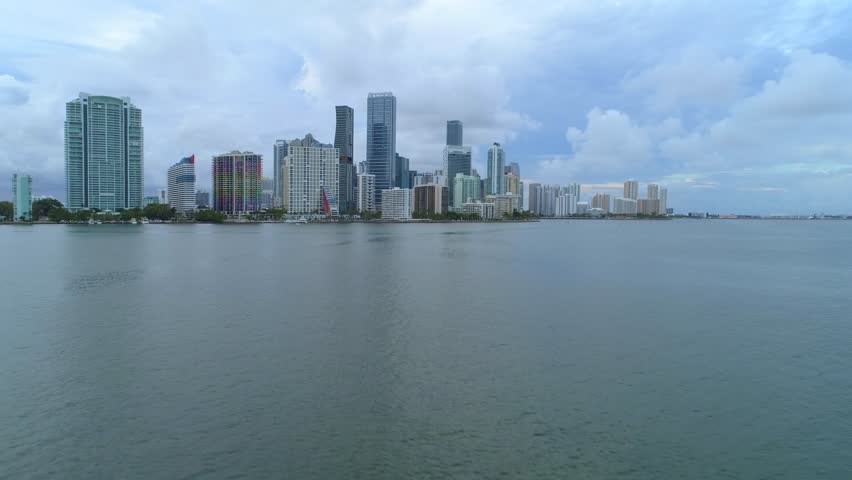 Aerial drone or boat approach to Brickell Miami city on bay