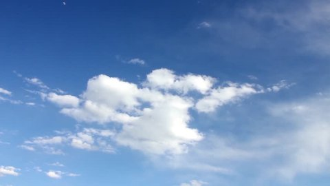 Beautiful white clouds soar across the screen in time lapse fashion over a deep blue background. Blue skies sky, clean weather, time lapse blue nice sky. Clouds and sky timelapse, FHD, 30 FPS.