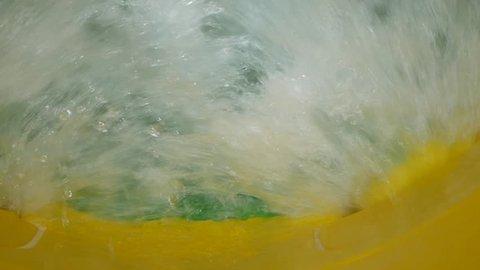 foaming water in pipe on water slide in amusement park. slow motion