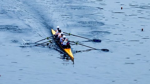 Philadelphia, PA / USA - 5/11/2018: Dad Vail Regatta, group of four person oared rowing boat race over river
