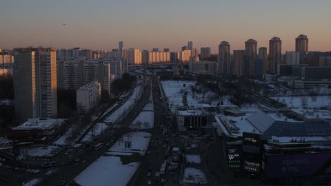 Aerial view Beautiful frozen WINTER Moscow city cowered in snow and ice 4k