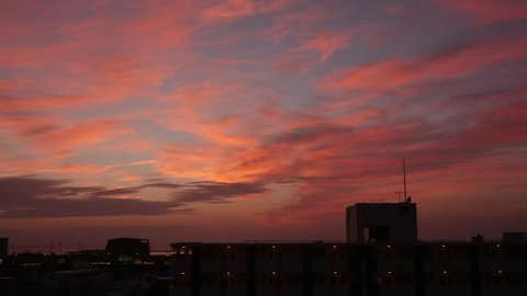Still low angle timelapse on beautiful sunset in Japan city. Shot location is at Japan Okinawa. Red sky fade into darkness.