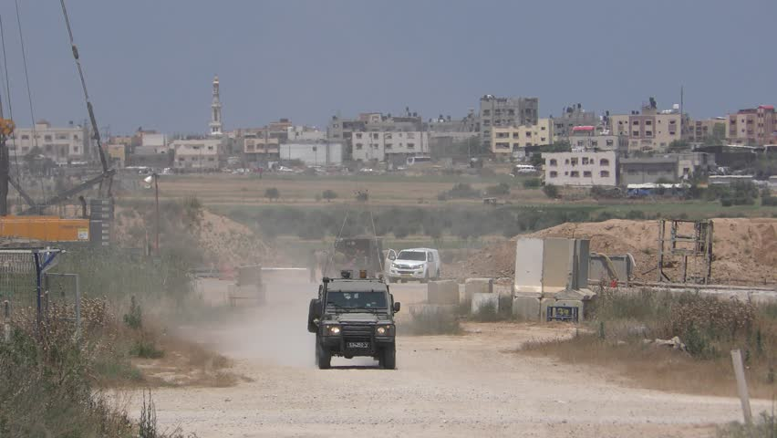 Military Israeli vehicles pass near the border with Gaza Strip during demonstrations in commemoration of Nakba Day or Day of Catastrophe.. Gaza Strip border, May 14, 2018