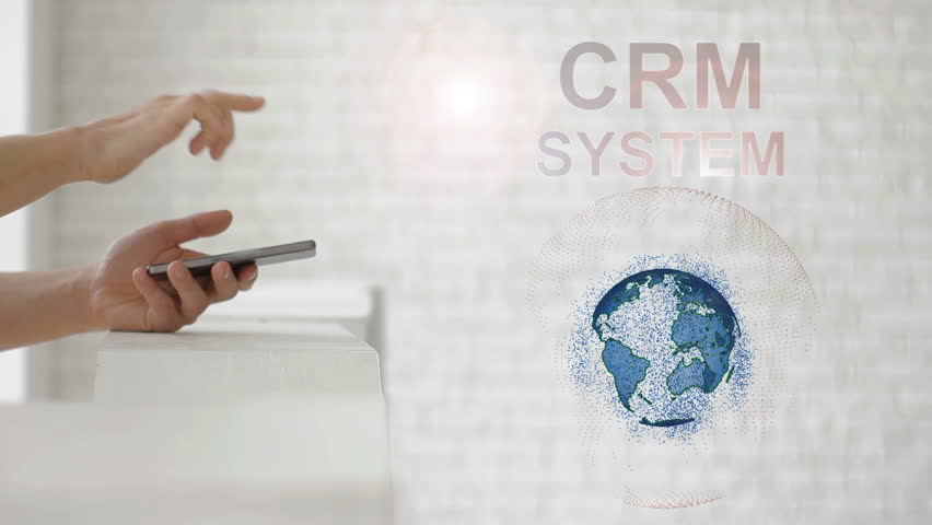Hands launch the Earth's hologram and CRM system text. Man with future technology phone is showing a 3d projection on a modern white background