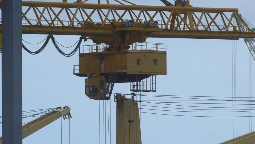Detail of cranes moving at a container port in Palermo | Shutterstock HD Video #1011404009