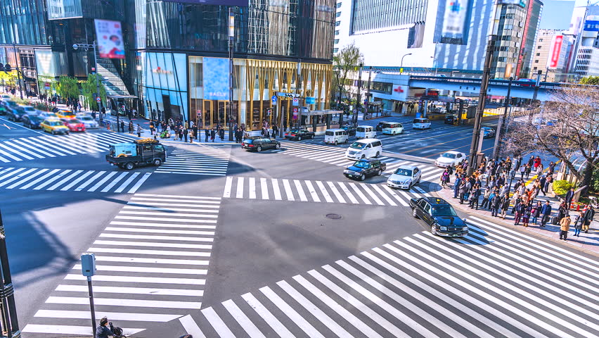4K,Time lapse traffic and crowd people at ginza district intersection in Tokyo of Japan | Shutterstock HD Video #1011427619