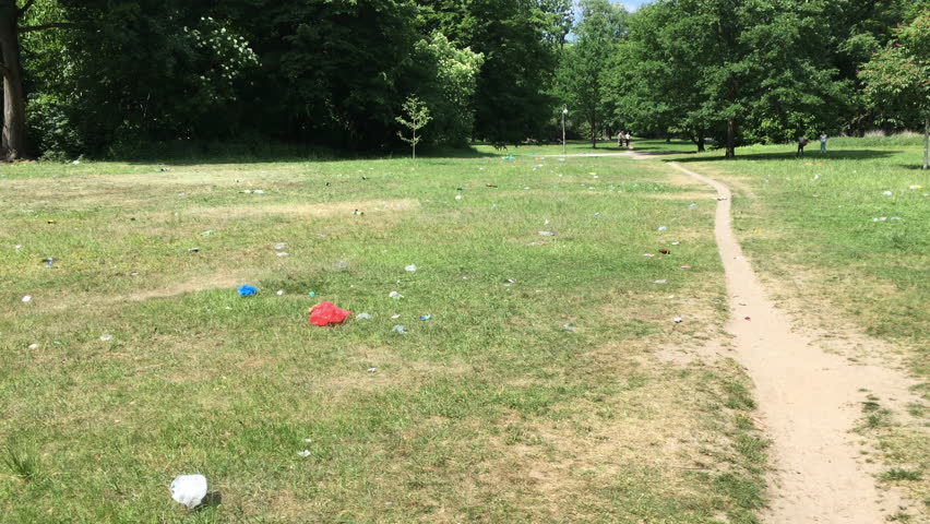 "Berlin, Germany - May 23 2018: Trash scattered in a Public Park after Festival ""Karneval der Kulturen"""