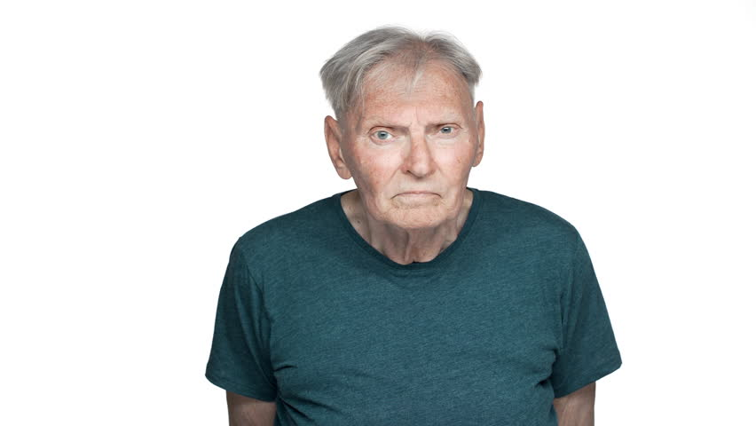 Portrait of serious old aged man 80s having gray hair in basic t-shirt grimacing and looking at camera with suspicious gaze, isolated over white background | Shutterstock HD Video #1011483269