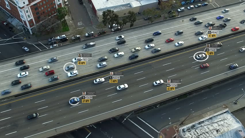 Highway aerial view with fake car speed, plate number, driver information and ID. Perfect to illustrate concepts as: surveillance, big data, traffic control, futuristic cities. Future transportation.  | Shutterstock HD Video #1011485609