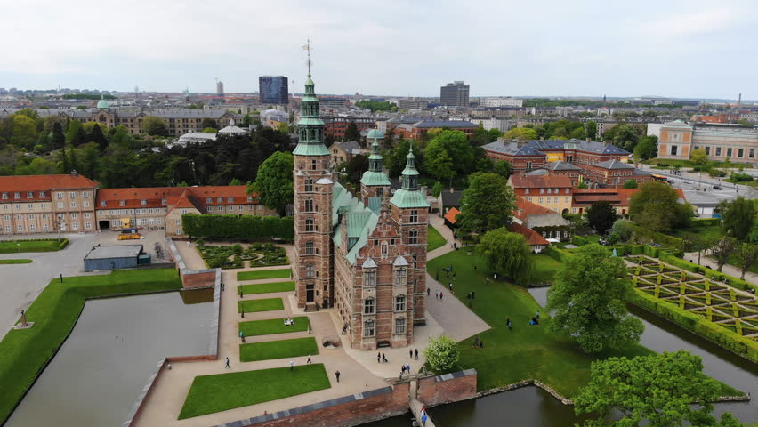 Aerial view of Rosenborg Castle (renaissance style palace) situated in The King's Garden (Kongens Have) - central Copenhagen, capital city of Denmark from above | Shutterstock HD Video #1011516239
