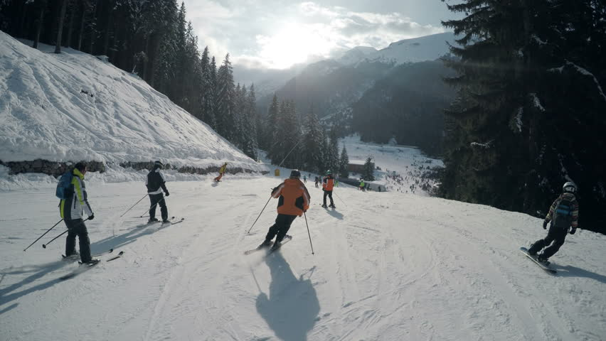 Sports athletes have fun while skiing in the winter on the slopes of Bansko, Bulgaria
