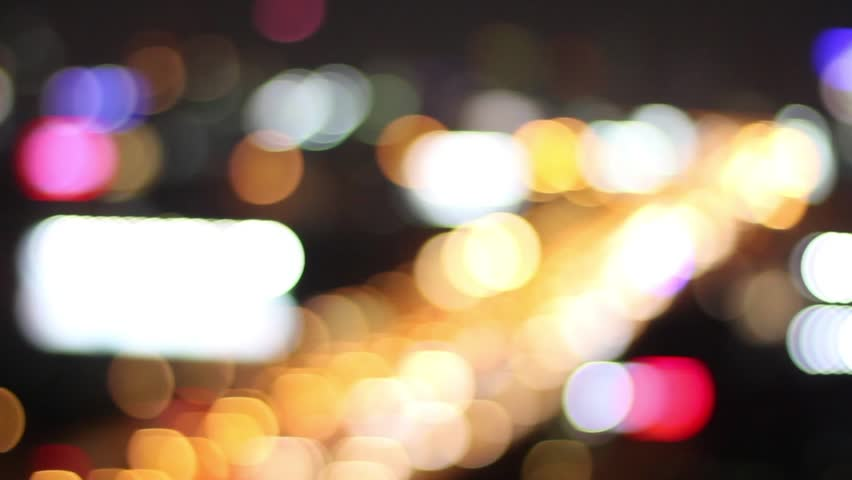 Beautiful Bokeh light of real road traffic in the city at night   Shutterstock HD Video #1011540809