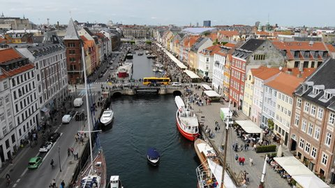 Aerial view of cityscape of Copenhagen, Nyhavn (famous historic district with canal and brightly coloured houses) - capital city of Denmark from above, Europe