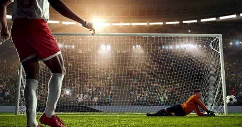 Soccer goalie fails to catch a ball on a prefessional soccer stadium. Athlete wears unbranded sport clothes