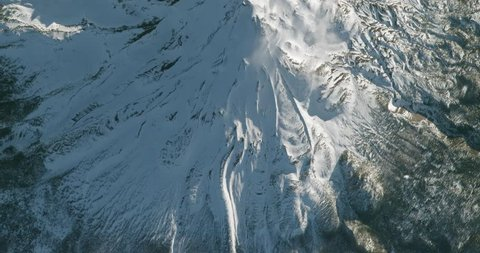 Very high-altitude overflight aerial of Mount Shasta, California. Clip loops and is reversible. Elements of this image furnished by NASA