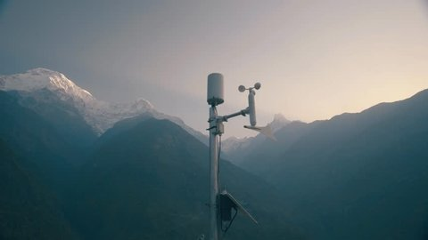 Anemometer Weather station working against Huge Mountain Covered Snow in Background in Morning