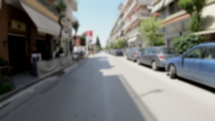 Driving in the City, blurred video suitable for use with green screen for the rear view windows of a car,  Captured with wide angle lens, In camera Stabilizer, No post editing, 4k video 3840X2160