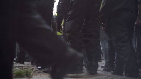 Riot police officers boots march in street, radical violent protest, Berlin
