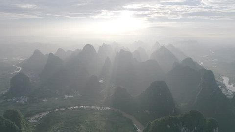 Breathtaking aerial establishing shot over beautiful limestone karst mountain scenery, at sunset in Yangshuo County,China.Mountain landscape top view. D-Log profile