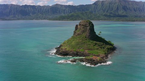 Oahu, Hawaii circa-2018. Aerial view of Mokolii Islet. Shot with Cineflex and RED Epic-W Helium.
