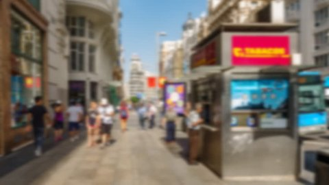Hyperlapse wide angle blurred view of tourist walking in gran Via, Madrid