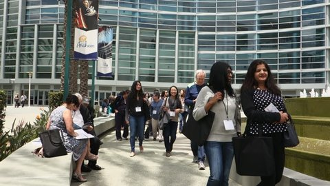 Anaheim, CA / USA - May 30, 2018: Attendees of a medical conference walk out of a meeting at the Anaheim Convention Center on a sunny day
