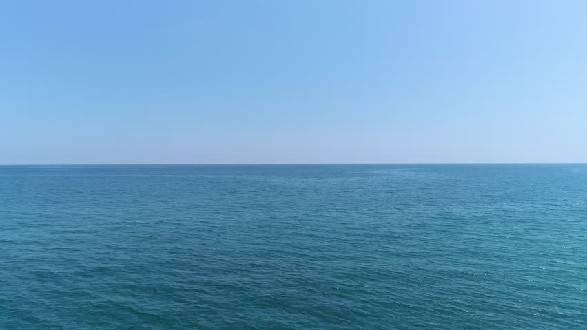 Panoramic view of infinite calm ocean | Shutterstock HD Video #1011801809
