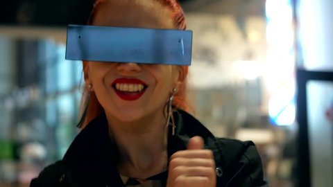 Red hair pretty fashion woman with stylish sunglasses has a fun and smiling in indoor close-up