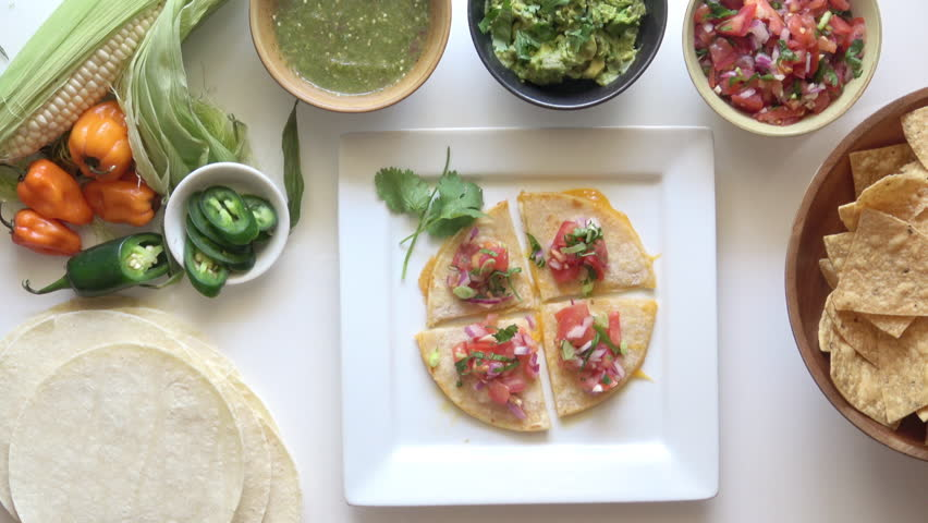 Fresh Quesadilla with Guacamole. Mexican Food served on a Bright White Background.