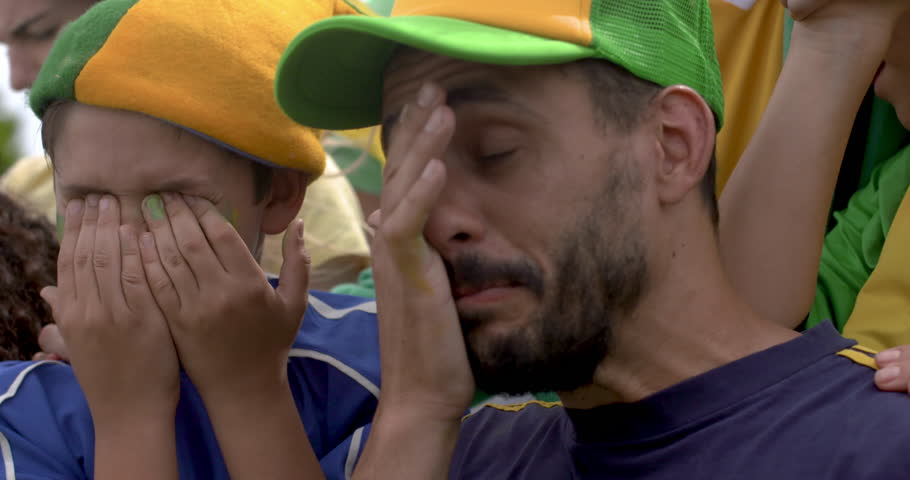 Father and son crying in disappointment after defeat at sports match | Shutterstock HD Video #1011913829