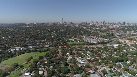Aerial shot of a Suburb in Johannesburg with the iconic city skyline