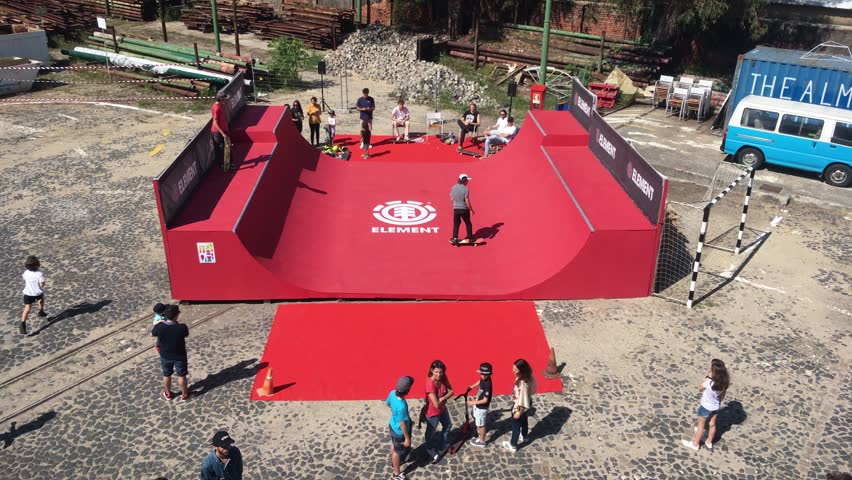 Skateboard Halfpipe Practicing Kids. LISBON, PORTUGAL - 05 MAI 2018; Teenagers learning how to skate on a halfpipe in a park. High angle view