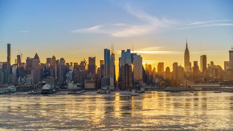 Midtown Manhattan skyline at sunrise in New York, timelapse of rising sun