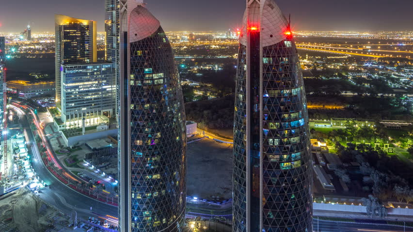 Skyline view of the buildings of Sheikh Zayed Road and DIFC night timelapse in Dubai, UAE. Illuminated skyscrapers in financial centre aerial view from above | Shutterstock HD Video #1011990299