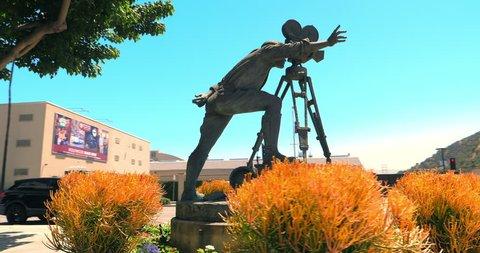 LOS ANGELES, CALIFORNIA, USA - JUNE 3, 2018: Bronze sculpture of the Hollywood cameraman near Warner Brothers Pictures Studios in Burbank, Los Angeles, California, 4K