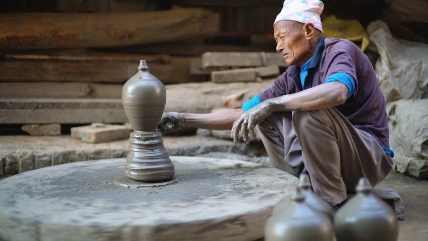 BHAKTAPUR, NEPAL - 22TH December 2017:The older man make pottery on the Pottery square in Bhaktapur, Nepal, Asia. | Shutterstock HD Video #1012030469