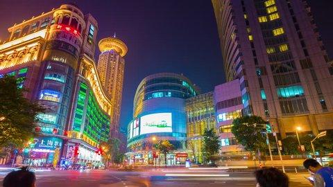 SHANGHAI, CHINA - SEPTEMBER 20 2017: night illuminated shanghai city center traffic street crossroad panorama 4k timelapse circa september 20 2017  shanghai, china.