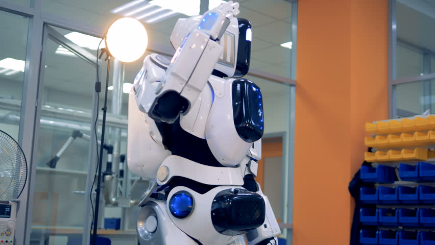 A droid makes movements with its arm. | Shutterstock HD Video #1012049969