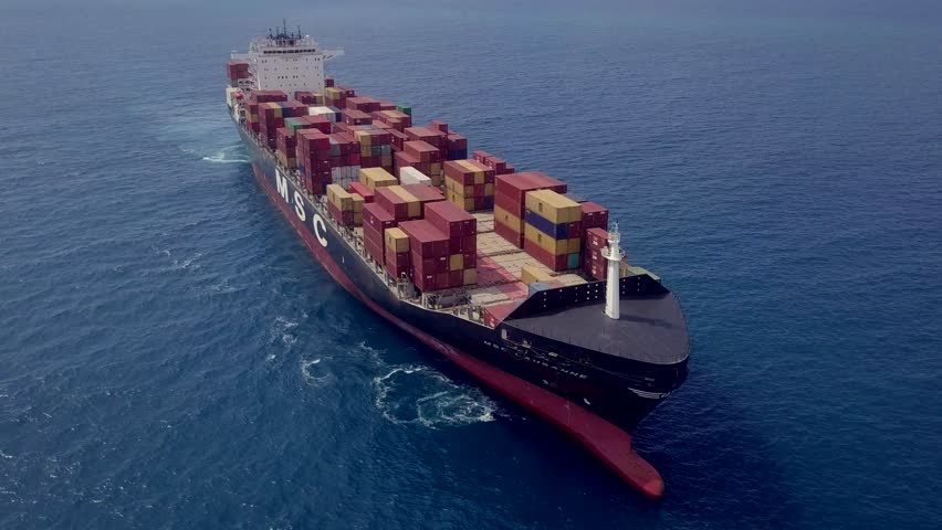 Mediterranean Sea - June 3, 2018: Aerial footage of an MSC (Mediterranean Shipping Company) container ship at sea.